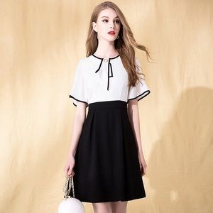 White top and black bottom short sleeves dress